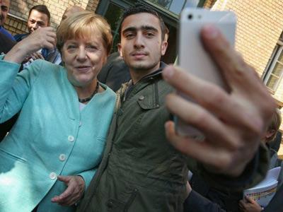 سلفی پناهنده ی سوری با آنگلا مرکل